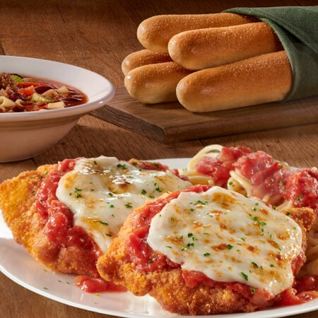 Two lightly fried Parmesan breaded chicken breasts topped with our homemade marinara sauce and melted Italian cheeses served with spaghetti.