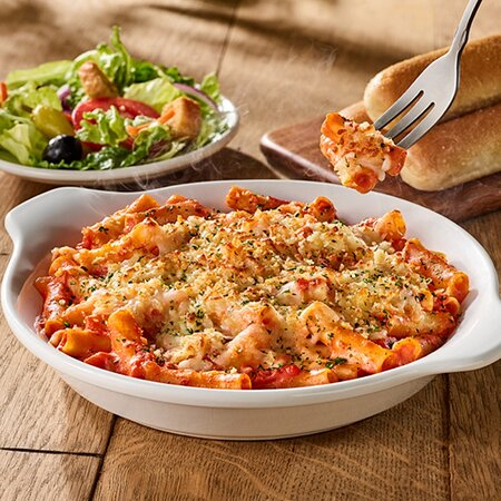 A baked blend of Italian cheeses, pasta and our signature five cheese marinara.