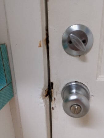 Entry door to Condo busted up