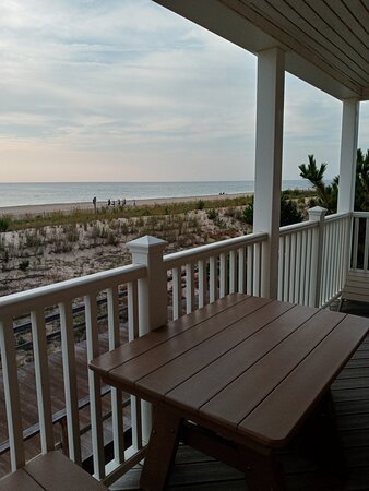 View from Oceanfront balcony with small picnic table. With the exception of the very loud AC unit, this was the best part of this condo