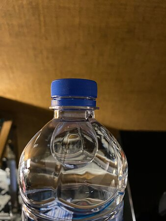 Open complimentary water left in room by previous guests.