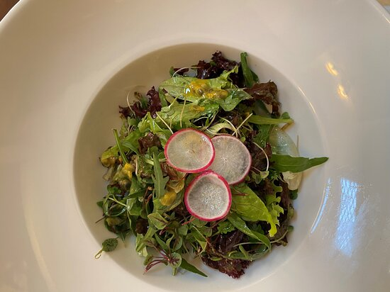 Delicious salad with passion fruit and olive oil dressing.