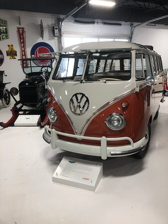 VW bus and old  car on skis.