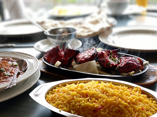 Delicious and Tender Lamb Tikka straight out of Tandoori oven served with Rice and Sauce