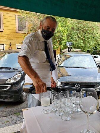 Giulio pouring prosecco