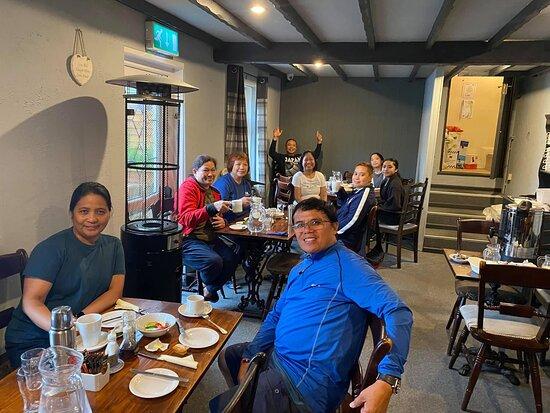 Filipino bunkhouse guests having breakfast