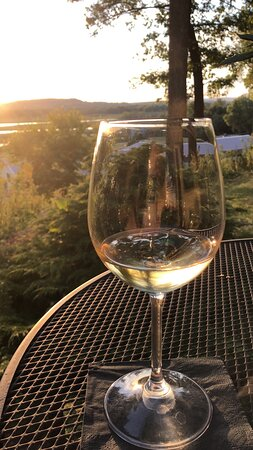 Arrive, unwine, relax with a delicious glass of wine while taking in amazing views of the Mississippi River.