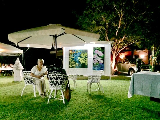 Guests enjoying an evening event in our painting and sculpture gardens