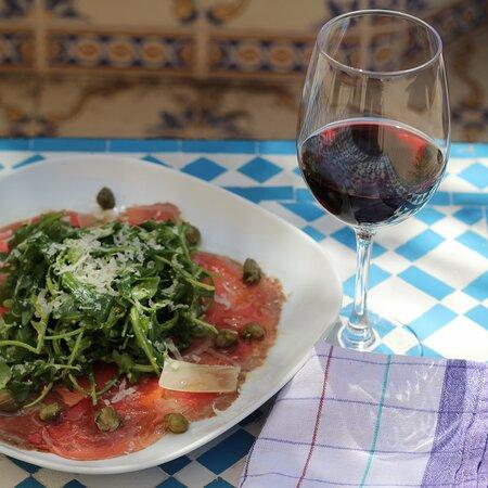 Beef carpaccio, rocket salad, shaved parmesan,capers & aioli