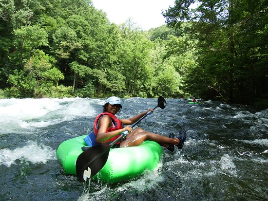 She is having the time of her life, passing on the left keeps us from flipping and we enjoy the great waves of Bee Cliff on Watauga River -  Guided Extreme Tube Trip