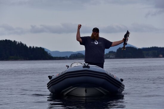 Andy celebrates victory over a dead salmon that disabled one of our outboards for a short while.