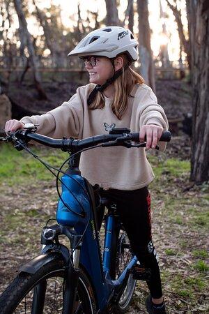 A teenager enjoying riding an extra small e-bike