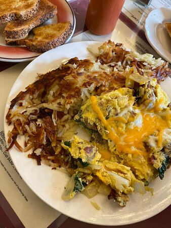 Great service and atmosphere!  Of course, the food is fantastic. Huge portions as others have noted. This is the bacon Florentine omelette which was enough for two or three people. The hot sauce and jam are divine!