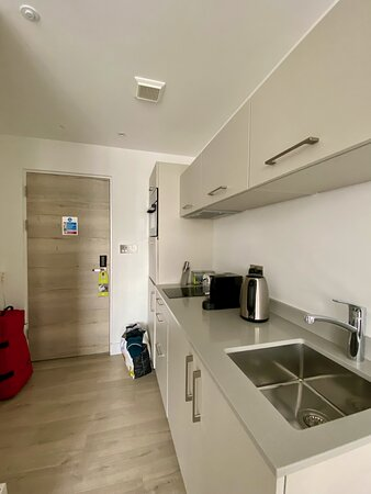 They manage to squeeze a sink, fridge, microwave, dishwasher and washing machine into this small space!