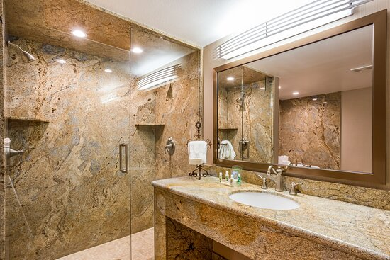Relax in our Guest Bathroom with modern marble finish.