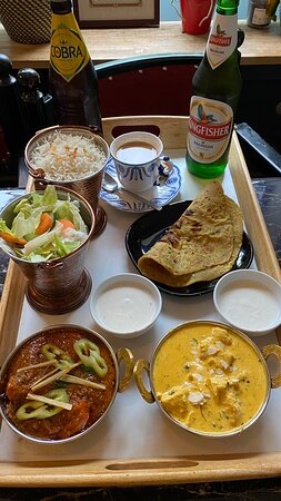 Indian popular curries like chicken tikka masala and butter chicken with our special drinks