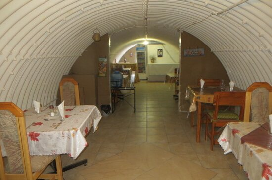 Epikaizo Guest House, Outapi, Namibia: dining area constructed inside the military bunker, which is a relic from the times of the so-called Border War that tool place in the northern regions of Namibia in the two decades before the country attained its Independence.