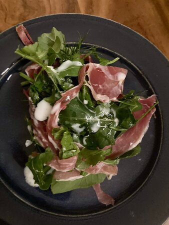 Poached plum and beetroot salad with prosciutto