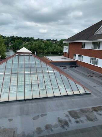 """Lovely """"river view"""" of damp roof sheeting, and of the balcony room that we were supposed to be in"""