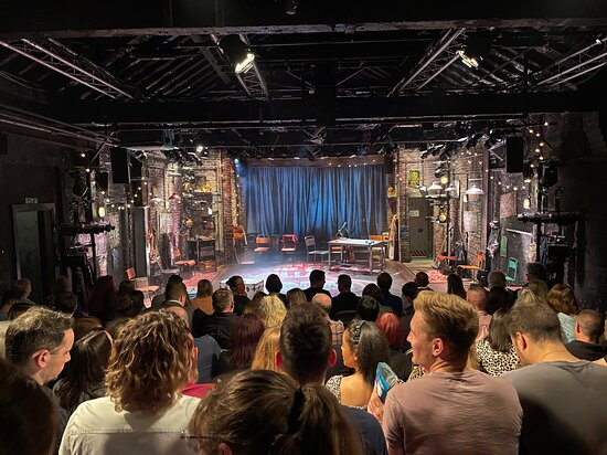 Theatre auditorium at capacity.