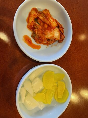 Their standard, complimentary side dishes - kimchee and sweet pickled radish/sliced onions