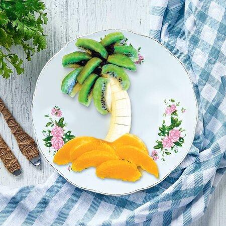 Fruits Plate  AED Fun Platter Of Fresh Fruits Banana Orange and Kiwi