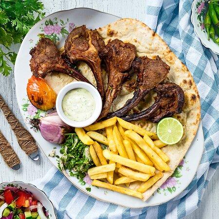 Ryash Barbeque (Lamb Chops)  Grilled lamb ribs served with yogurt, Arabic salad, fresh potato and tanoor bread