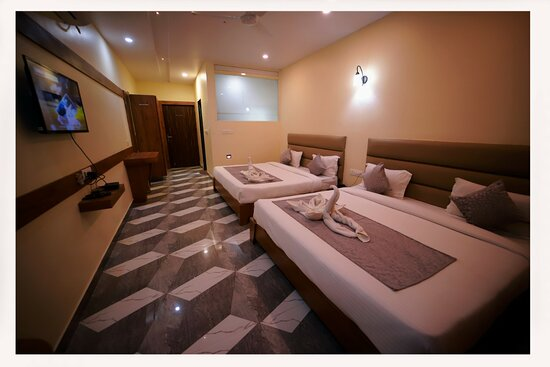 There are 48 rooms with inclusive of 4 suites , huge green space close to nature within the hearts of the city . It's situated centrally near the Inter state bus terminal , national highway all within the range of two kms