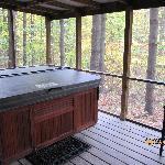 hot tub w/ screened in porch