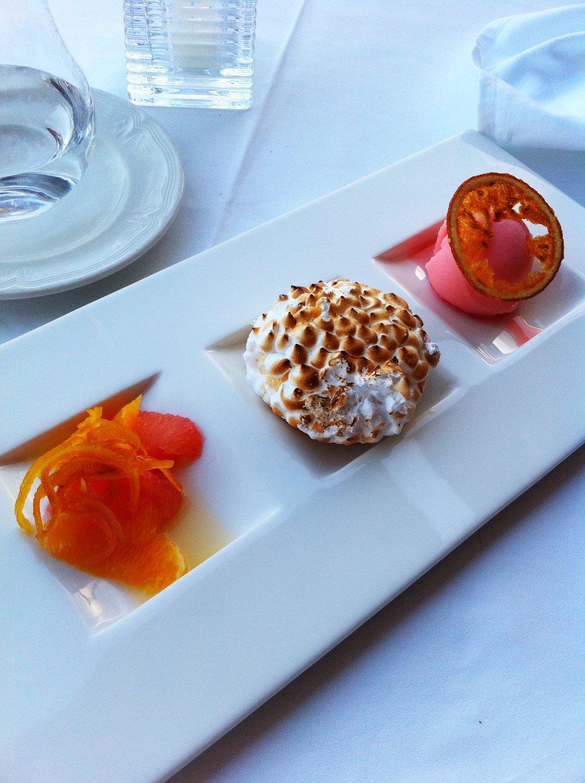 Lemon meringue tart, citrus salad and grapefruit sorbet (32160691)