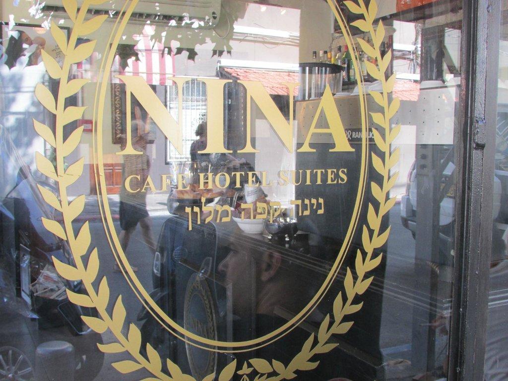 Nina Cafe Suites Hotel