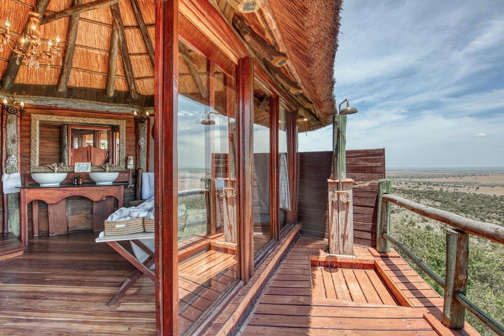 View of bathroom and outdoor rain shower in Luxury Safari Room at Mbali Mbali Soroi Serengeti Lodge