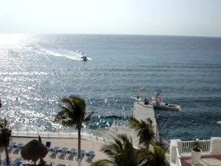 Cozumel Palace view of  ocean, pool, and pick-up-tour boats