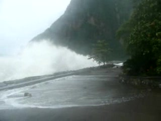 Sugar Beach, A Viceroy Resort : Waves washing up on Beach Road