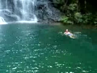 Swimming in mountain waterfall pool at Cockscomb Jaguar Reserve