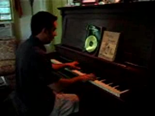 Guest at the Inn plays piano in one of our guest areas