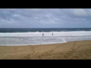 Kilauea, HI: Gary and his nephew playing in the waves