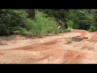 Chalong, Tailandia: Wheelie on dirt bike - motocross, Phuket, Thailand