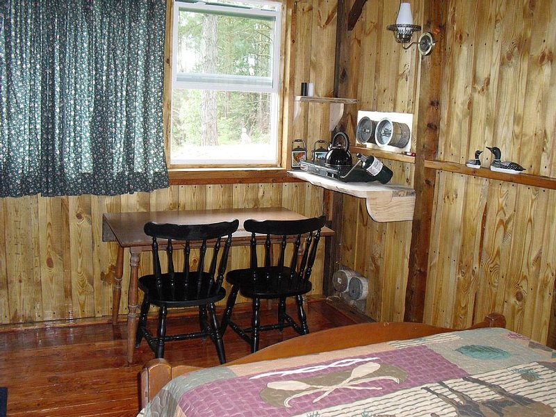 Small dining area inside cabin.