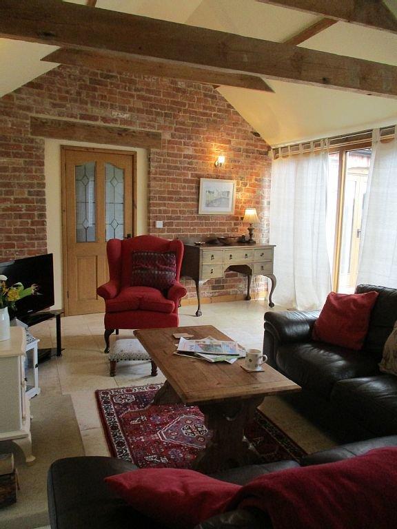 Sitting room floor to ceiling windows.Door to courtyard. 1 step to bedroom wing