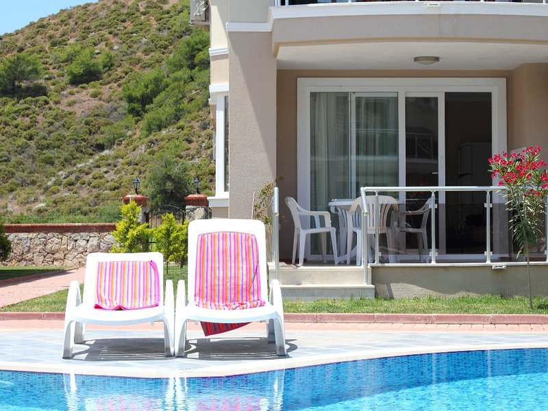 Beautiful beachfront apartment with pool in stunning location, sleeps 4, holiday rental in Fethiye