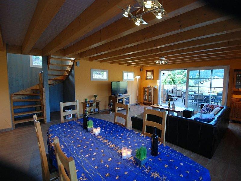 Sala de jantar e lounge com abertura do terraço