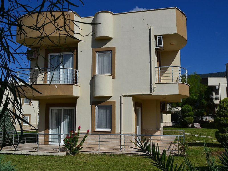 Side view of the villa showing the balconies from the main and second bedrooms