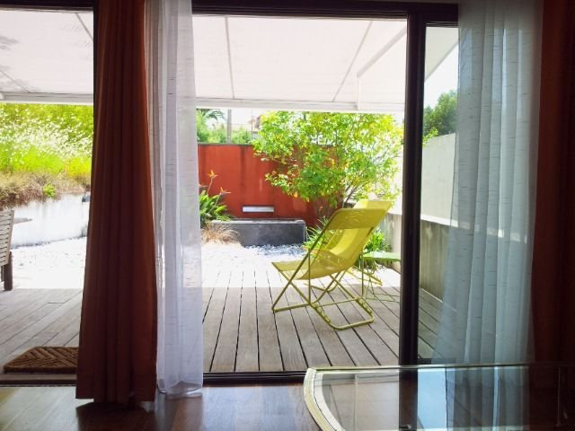 the view of the terrace and the garden from the living room