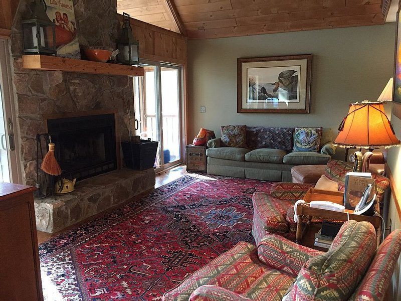 Living Room on the main floor with wood burning fireplace (firewood provided)