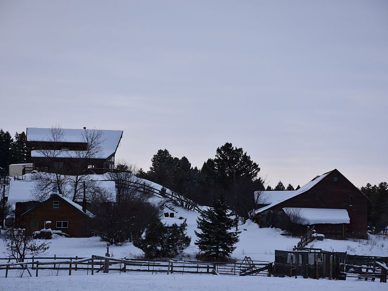 Winter scene of the ranch, showing barn, two other homes, with Haven on Hill.