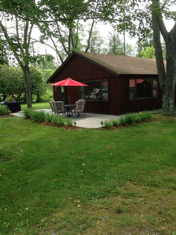 Front view of cabin and patio 2013