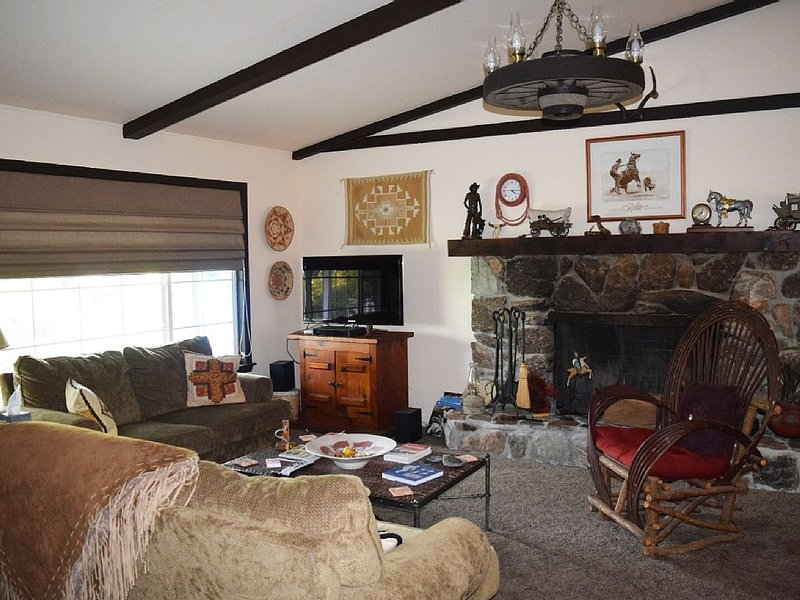 Spacious living room is roomy and comfortable  with interesting western decor.