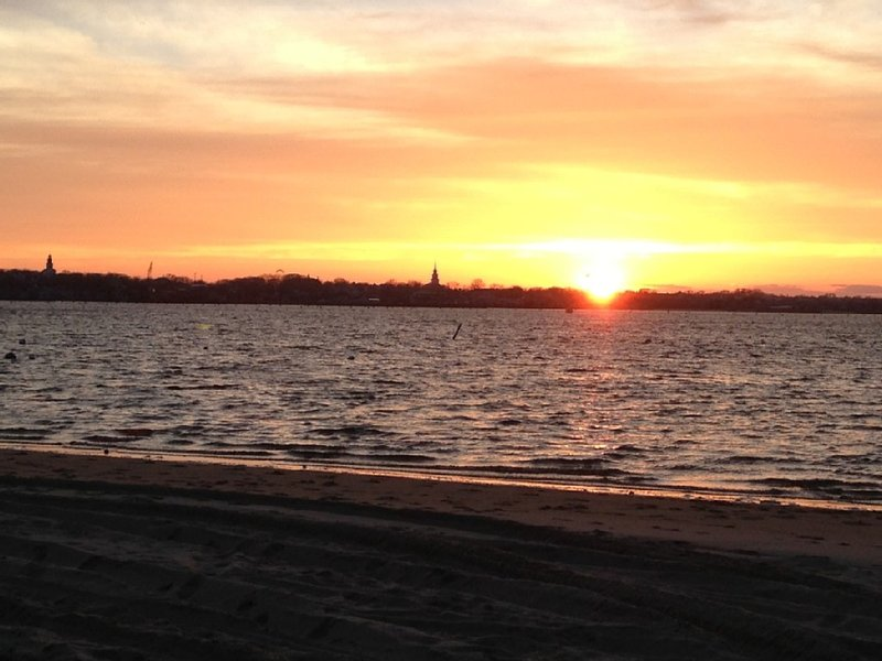 Early Spring sunset over Nantucket town from Monomoy Beach.