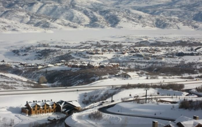 View from Deer Valley Gondola of Fox Bay condos and frozen Jordanelle Reservoir